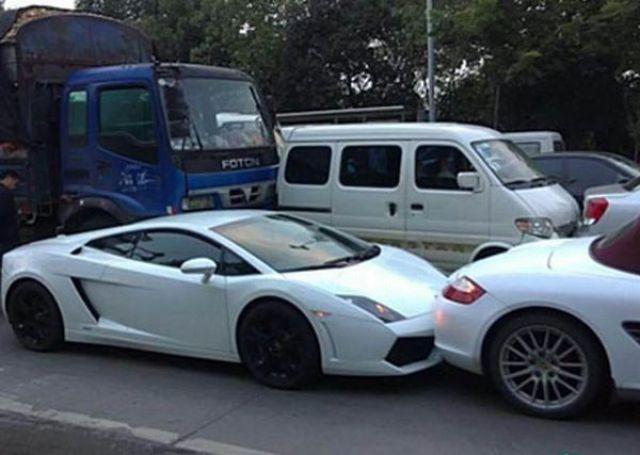 a Porsche, a Rolls Royce Phantom, and a Lamborghini in one wreck.