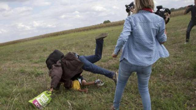 Hungarian Camerawoman Loses Her Job after Kicking Refugees on Camera